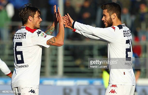 Daniele Dessena of Cagliari Calcio celebrates with his teammate Simone Benedetti after scoring their first goal during the Serie A match between...