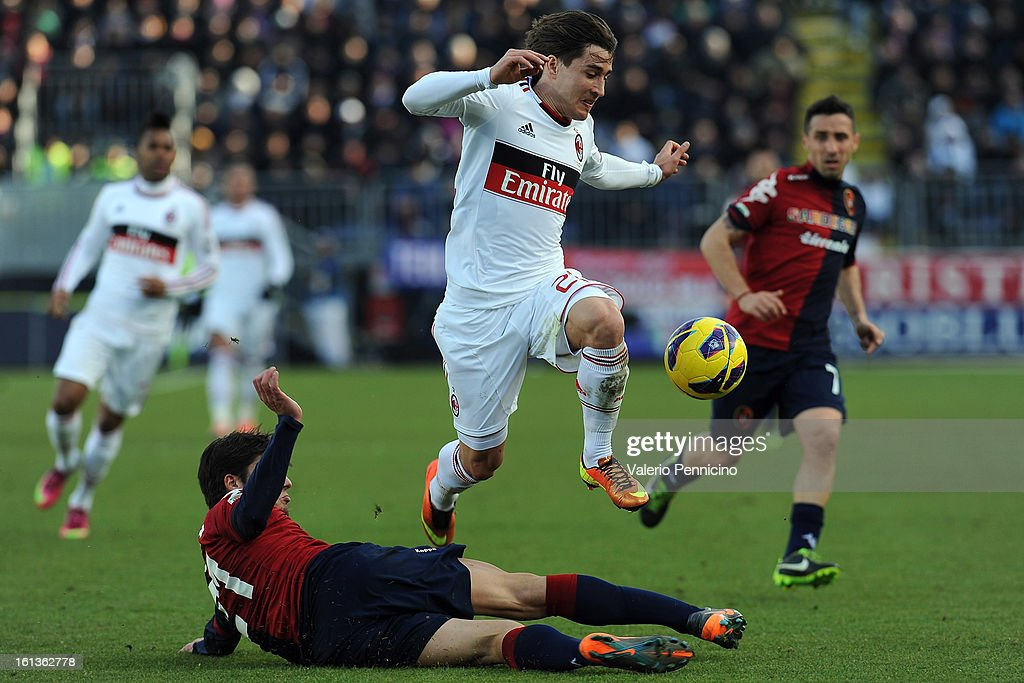 Daniele Dessena (L) of Cagliari Calcio tackles Krkic Bojan of AC Milan during the Serie A match between Cagliari Calcio and AC Milan at Stadio Is Arenas on February 10, 2013 in Cagliari, Italy.