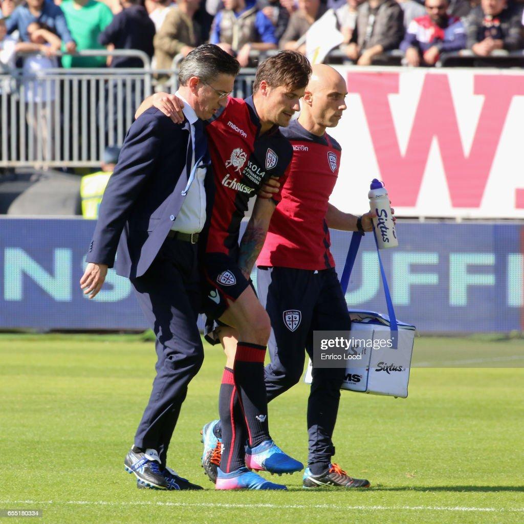 Daniele Dessena of Cagliari injured during the Serie A match between Cagliari Calcio and SS Lazio at Stadio Sant'Elia on March 19, 2017 in Cagliari, Italy.