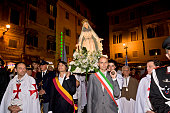 Daniele Frongia deputy mayor of Rome leads the procession of the statue of the 'Madonna della Fiumarola' 'River Mary' as it is carried during the...