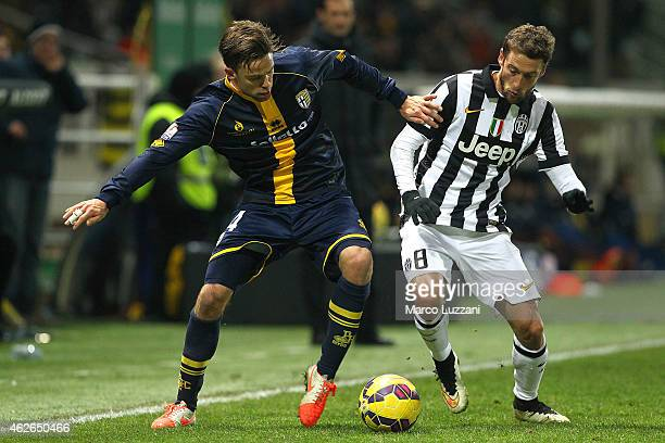 Daniele Galloppa of Juventus FC competes for the ball with Claudio Marchisio of Parma FC during the TIM Cup match between Parma FC and Juventus FC at...
