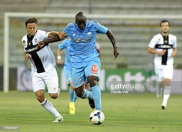 Daniele Galloppa of Parma FC and Souleymane Diawara of Olympique Marseille compete for the ball during the preseason friendly match between Parma FC...