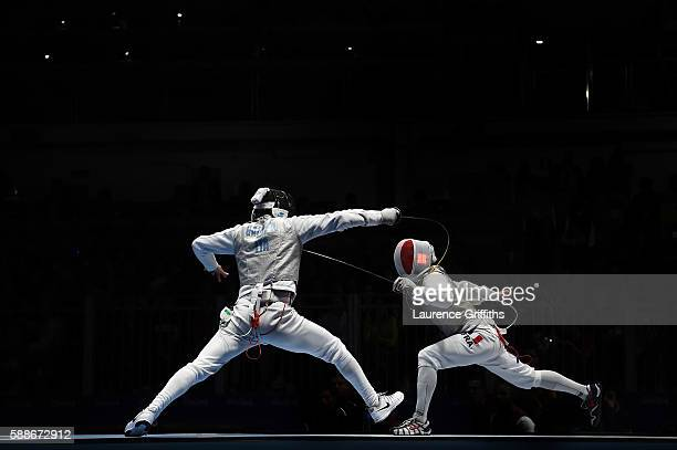 Daniele Garozzo of Italy competes against Erwan le Pechoux of France during a Men's Foil Team Semifinal bout on Day 7 of the Rio 2016 Olympic Games...