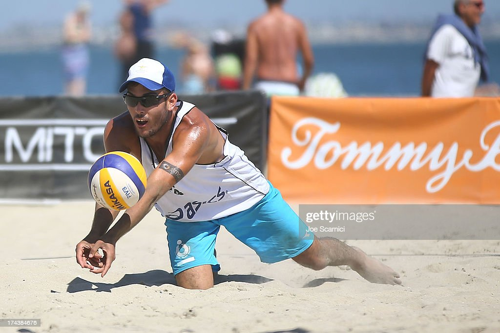 <a gi-track='captionPersonalityLinkClicked' href=/galleries/search?phrase=Daniele+Lupo&family=editorial&specificpeople=9207759 ng-click='$event.stopPropagation()'>Daniele Lupo</a> of Italy dives for the ball during the round of pool play at the ASICS World Series of Beach Volleyball - Day 3 on July 24, 2013 in Long Beach, California.