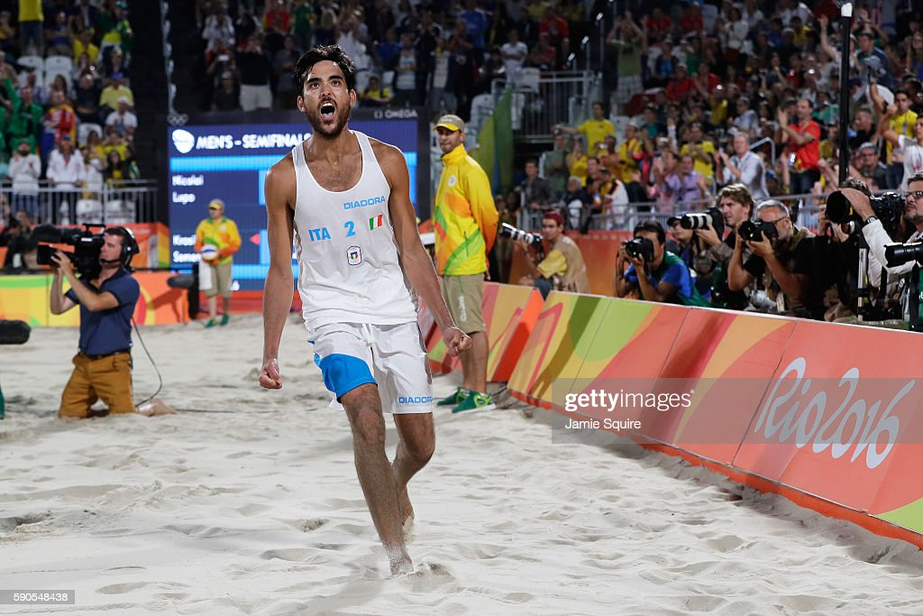 Daniele Lupo of Italy playing with Paolo Nicolai of Italy celebrates winning the beach volleyball Men's Semi final against Viacheslav Krasilnikov and Konstantin Semenov of Russia on Day 11 of the Rio 2016 Olympic Games at the Beach Volleyball Arena on August 16, 2016 in Rio de Janeiro, Brazil.
