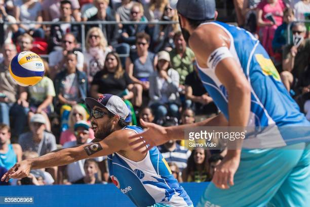 Daniele Lupo of Italy receives the ball during the bronze medal match against Piotr Kantor and Bartosz Losiak of Poland at the Swatch Beach...