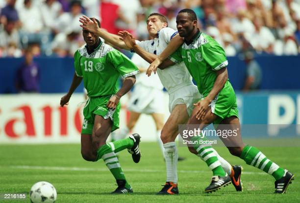 Daniele Massaro of Italy is crowded out by Michael Emenalo and Uche Okechukwu of Nigeria during the FIFA World Cup Finals 1994 Second Round match...
