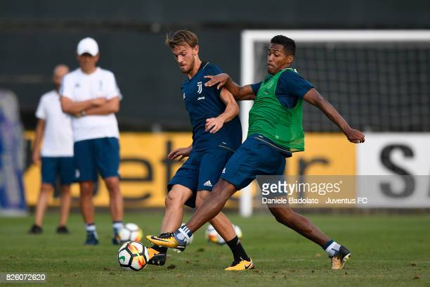 Daniele Rugani and Alex Sandro of Juventus during a training session on August 3 2017 in Vinovo Italy
