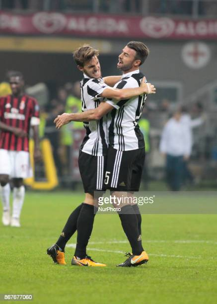 Daniele Rugani and Andrea Barzagli during Serie A match between Milan v Juventus in Milan on October 28 2017