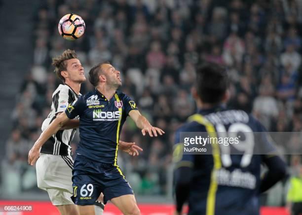 Daniele Rugani and Riccardo Meggiorini during Serie A match between Juventus v Chievo Verona in Turin on april 8 2017