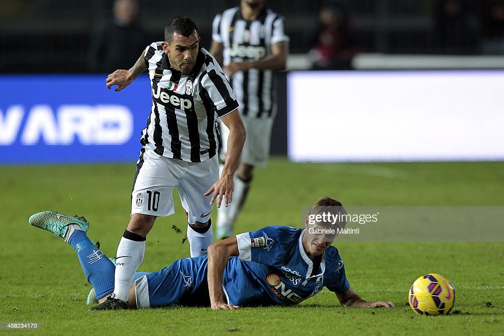 Daniele Rugani of Empoli FC battles for the ball with Carlos Tevez of Juventus FC during the Serie A match between Empoli FC and Juventus FC at Stadio Carlo Castellani on November 1, 2014 in Empoli, Italy.