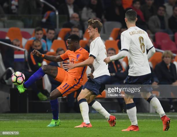Daniele Rugani of Italy competes for the ball with Quincy Anton Promes of Netherlands during the international friendly match between Netherlands and...