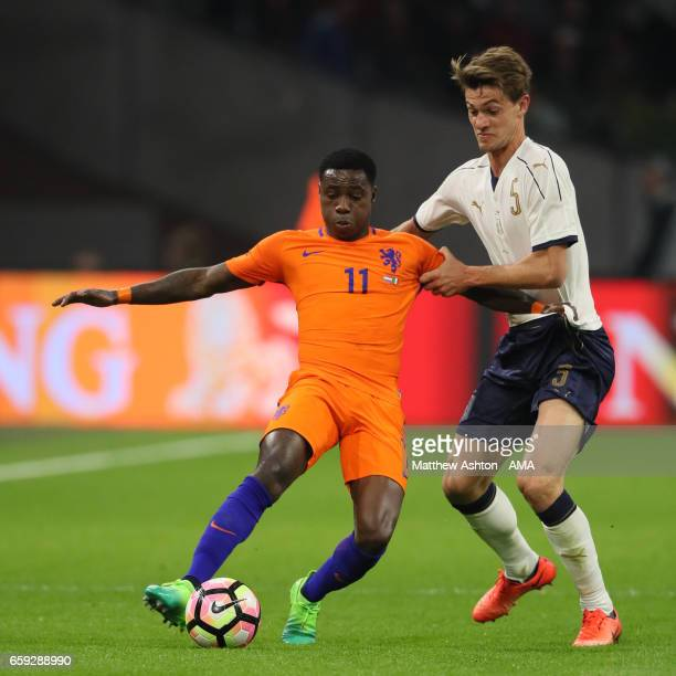Daniele Rugani of Italy competes with Quincy Promes of Netherlands during the international friendly match between Netherlands and Italy at Amsterdam...