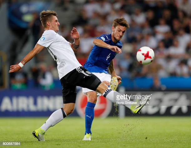 Daniele Rugani of Italy is challenged by MarcOliver Kempf of Germany during the UEFA European Under21 Championship Group C match between Italy and...