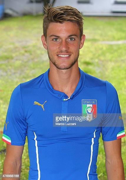 Daniele Rugani of Italy U21 poses with the shirt during the official Italy U21 portrait session at the training ground on June 13 2015 in Appiano...