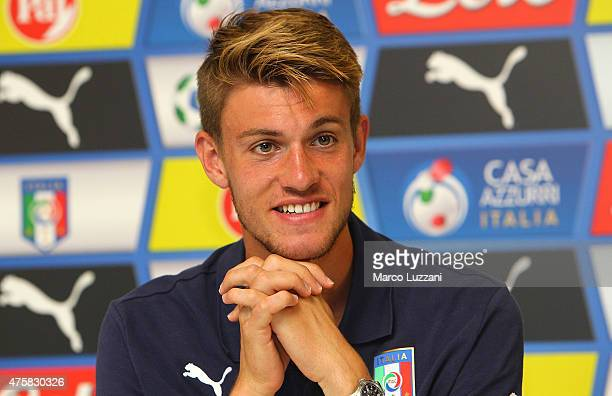 Daniele Rugani of Italy U21 speaks to the media during a press conference at the club's training ground on June 4 2015 in Appiano Gentile Como Italy