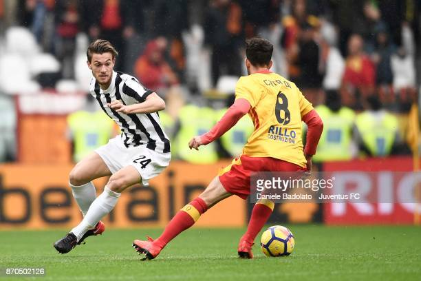 Daniele Rugani of Juventus and Danilo Cataldi of Benevento compete for the ball during the Serie A match between Juventus and Benevento Calcio on...