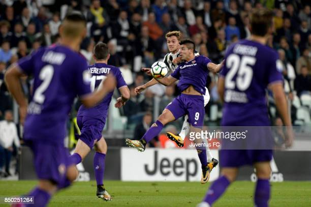 Daniele Rugani of Juventus and Giovanni Simeone of fiorentina compete for the ball during the Serie A match between Juventus and ACF Fiorentina on...