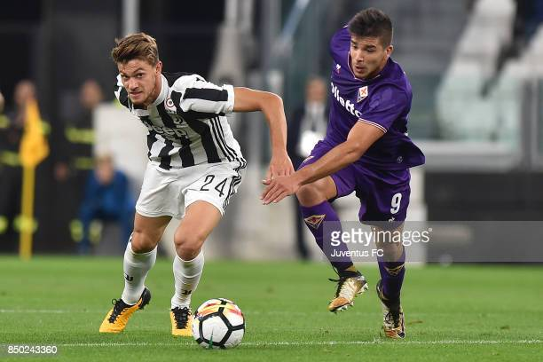 Daniele Rugani of Juventus and Giovanni Simeone of fiorentina competes for the ball during the Serie A match between Juventus and ACF Fiorentina on...