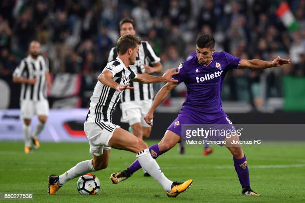 Daniele Rugani of Juventus and Giovanni Simeone of fiorentina in action during the Serie A match between Juventus and ACF Fiorentina on September 20...