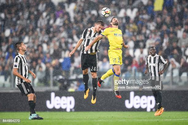 Daniele Rugani of Juventus and Sergio Pellissier of Chievo Verona competes for the ball during the Serie A match between Juventus and AC Chievo...