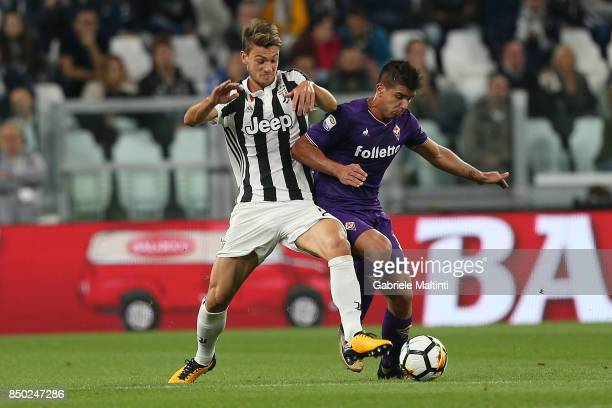 Daniele Rugani of Juventus battles for the ball with Giovanni Simeone of ACF Fiorentina during the Serie A match between Juventus and ACF Fiorentina...