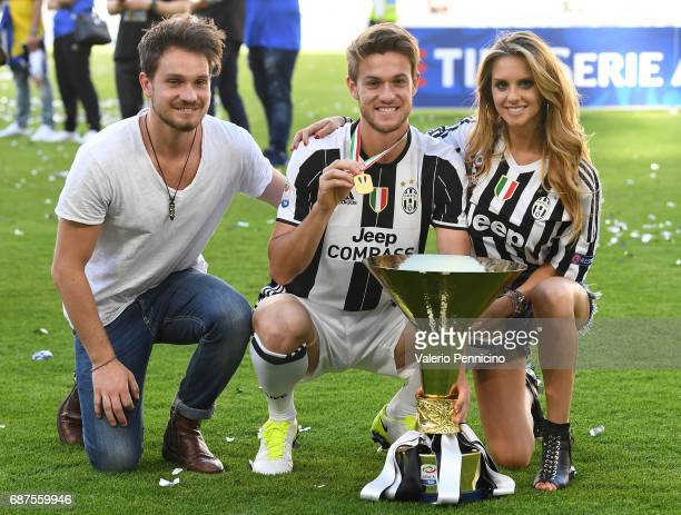 Daniele Rugani of Juventus FC and Michela Persico celebrate with the trophy after the beating FC Crotone 30 to win the Serie A Championships at the...