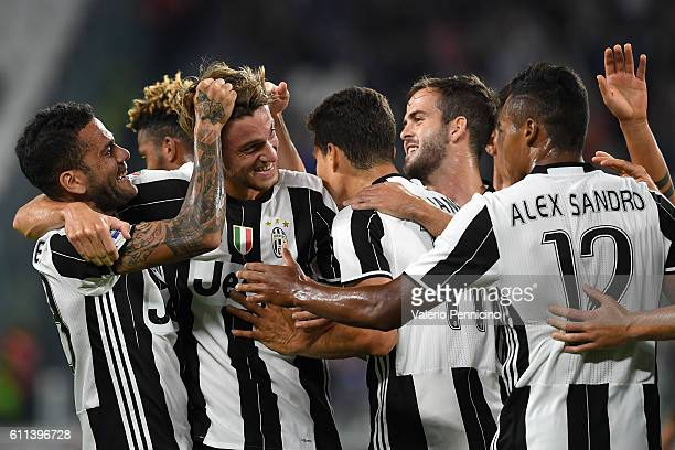 Daniele Rugani of Juventus FC celebrates after scoring the opening goal with team mates during the Serie A match between Juventus FC and Cagliari...