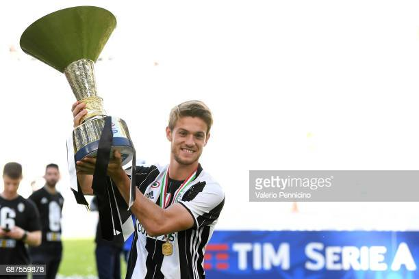 Daniele Rugani of Juventus FC celebrates with the trophy after the beating FC Crotone 30 to win the Serie A Championships at the end of the Serie A...