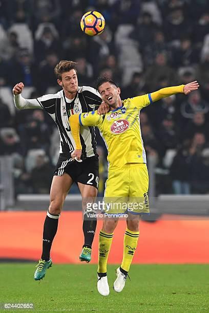 Daniele Rugani of Juventus FC clashes with Stefano Pettinari of Pescara Calcio during the Serie A match between Juventus FC and Pescara Calcio at...