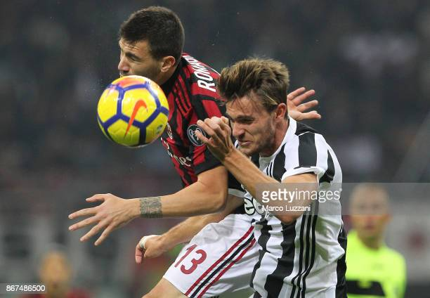 Daniele Rugani of Juventus FC competes for the ball with Alessio Romagnoli of AC Milan during the Serie A match between AC Milan and Juventus at...
