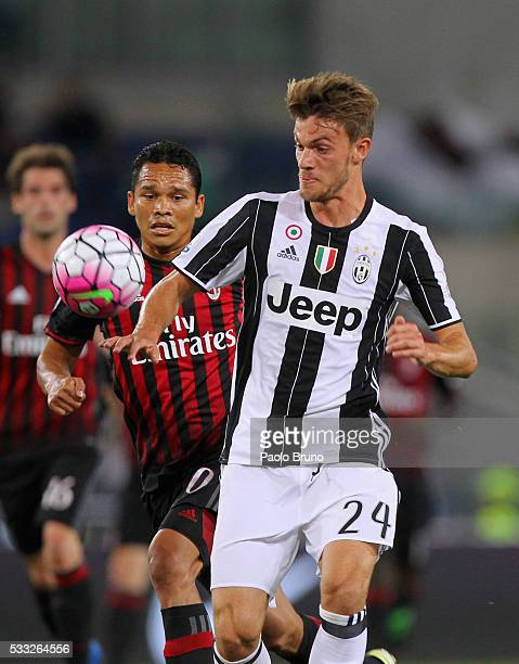 Daniele Rugani of Juventus FC competes for the ball with Carlos Bacca of AC Milan during the TIM Cup final match between AC Milan and Juventus FC at...
