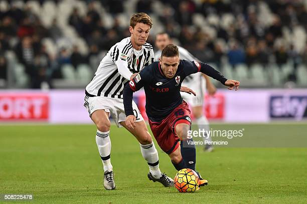 Daniele Rugani of Juventus FC competes with Diego Capel of Genoa CFC during the Serie A match between Juventus FC and Genoa CFC at Juventus Arena on...