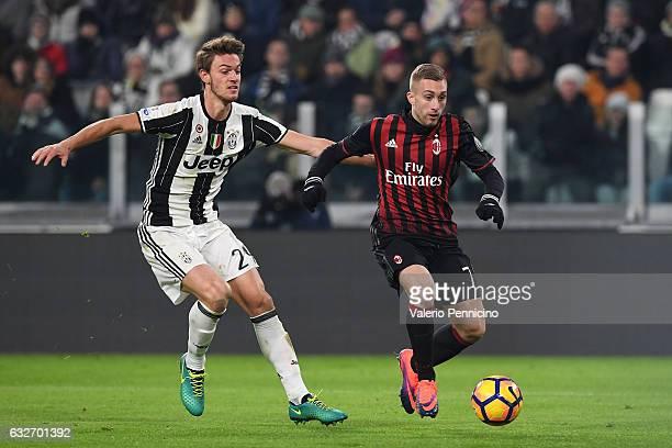 Daniele Rugani of Juventus FC competes with Gerard Deulofeu of AC Milan during the TIM Cup match between Juventus FC and AC Milan at Juventus Stadium...