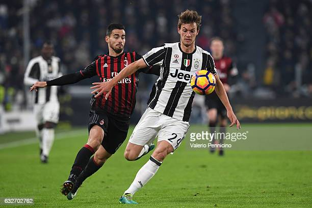 Daniele Rugani of Juventus FC is challenged by Fernandez Suso of AC Milan during the TIM Cup match between Juventus FC and AC Milan at Juventus...