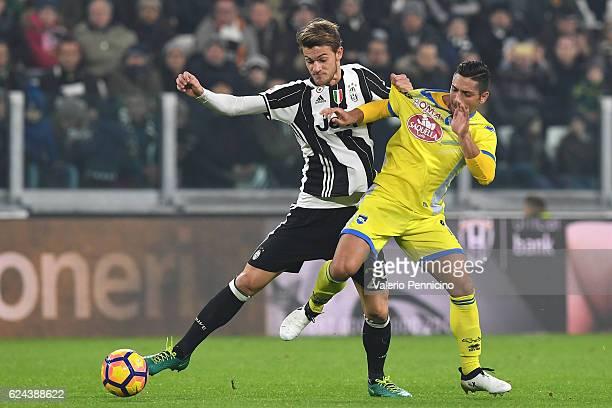 Daniele Rugani of Juventus FC is challenged by Gianluca Caprari of Pescara Calcio during the Serie A match between Juventus FC and Pescara Calcio at...