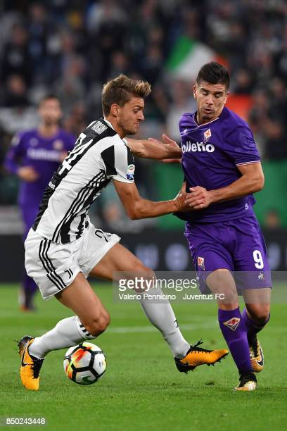 Daniele Rugani of Juventus Giovanni Simeone of fiorentina compete for Cyril Thereau ball during the Serie A match between Juventus and ACF Fiorentina...