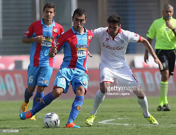 Daniele Sciaudone of AS Bari competes for the ball with Gonzalo Escalante during the Serie B match between Catania Calcio and AS Bari at Stadio...