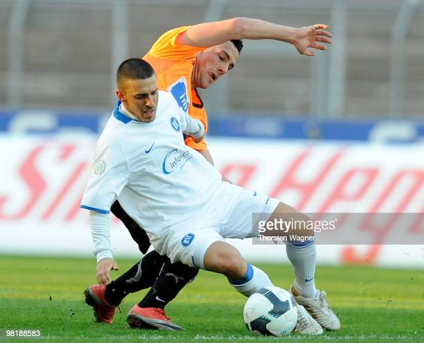 Daniele Toch of Karlsruhe battles for the ball with Ralf Kettemann of Aalen during the 4Liga match between Karlsruher SC II and VfR Aalen at the...