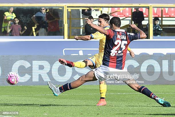 Daniele Verde of Frosinone Calcio kicks the ball past Adam Masina of Bologna FC during the Serie A match between Bologna FC and Frosinone Calcio at...
