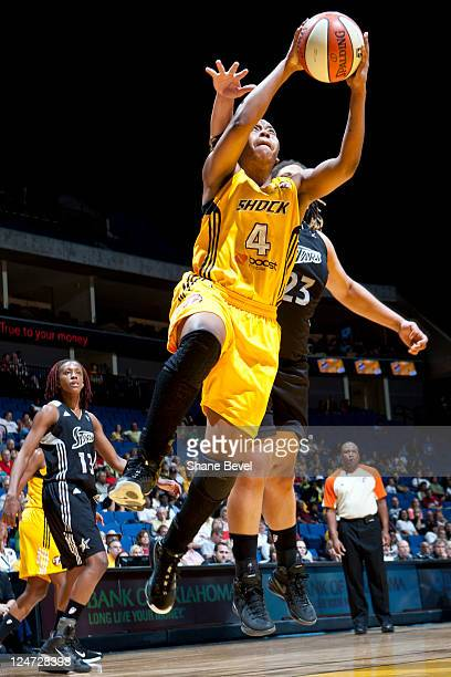 Danielle Adams of the San Antonio Silver Stars tries to stop a shot by Amber Holt of the Tulsa Shock during the WNBA game on September 11 2011 at the...