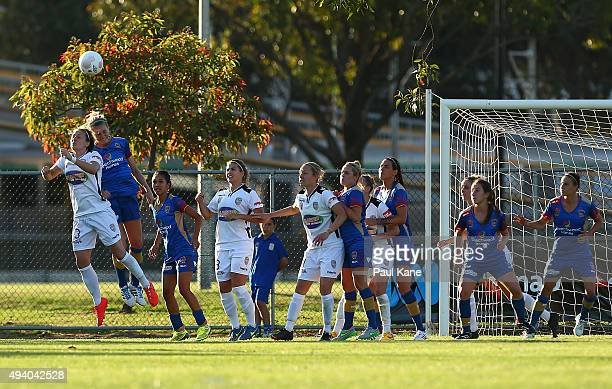 Danielle Brogan of the Glory and Megan Oyster of the Jets contest a header during the round two WLeague match between Perth Glory and the Newcastle...