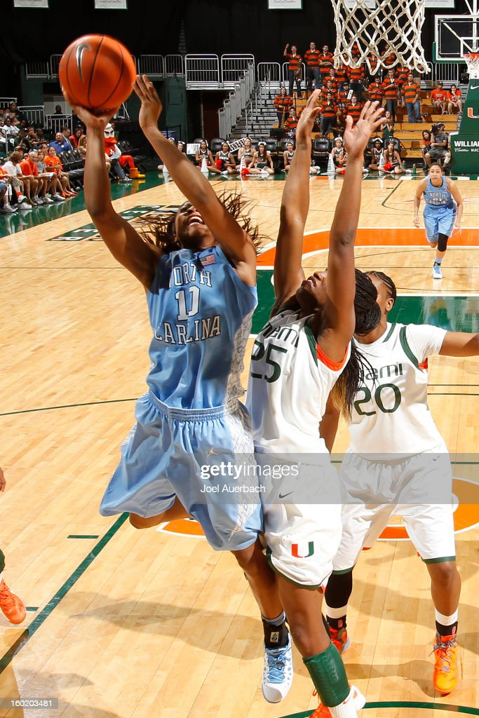 Danielle Butts #10 of the North Carolina Tar Heels scores over Jessica Capers #25 of the Miami Hurricanes on January 27, 2013 at the BankUnited Center in Coral Gables, Florida. The Tar heels defeated the Hurricanes 64-62.