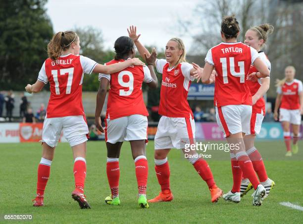 Danielle Carter celebrates scoring a goal for Arsenal Ladies with Heather O'Reilly and Jordan Nobbs during the match between Arsenal Ladies and...