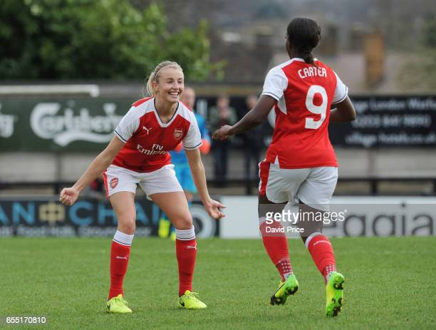 Danielle Carter celebrates scoring a goal for Arsenal with Leah Williamson during the match between Arsenal Ladies and Tottenham Hotspur Ladies on...