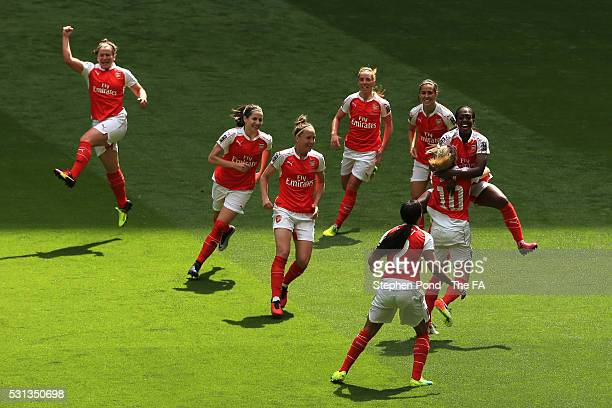 Danielle Carter of Arsenal celebrates scoring his team's first goal with her team mates during the SSE Women's FA Cup Final between Arsenal Ladies...