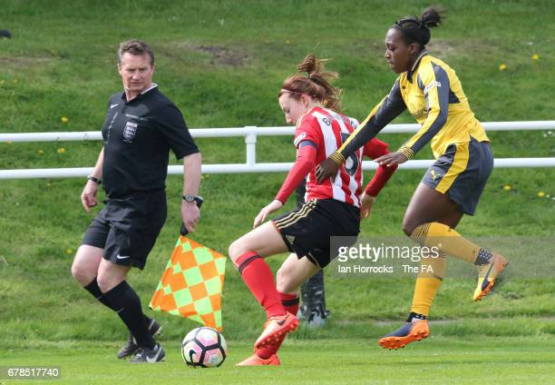 Danielle Carter of Arsenal chases down Stepanie Bannon of Sunderland during the WSL 1 Spring Series match between Sunderland AFC Ladies and Arsenal...
