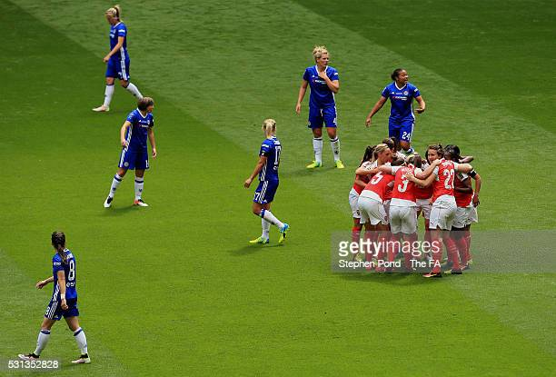 Danielle Carter of Arsenal is mobbed by team mates as she celebrates scoring the opening goal during the SSE Women's FA Cup Final match between...