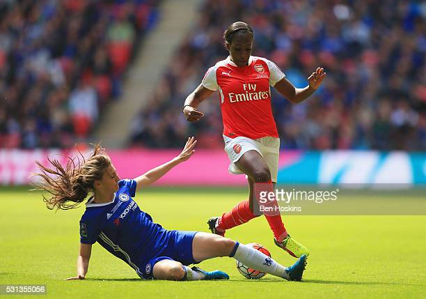 Danielle Carter of Arsenal is tackled by Hannah Blundell of Chelsea during the SSE Women's FA Cup Final between Arsenal Ladies and Chelsea Ladies at...
