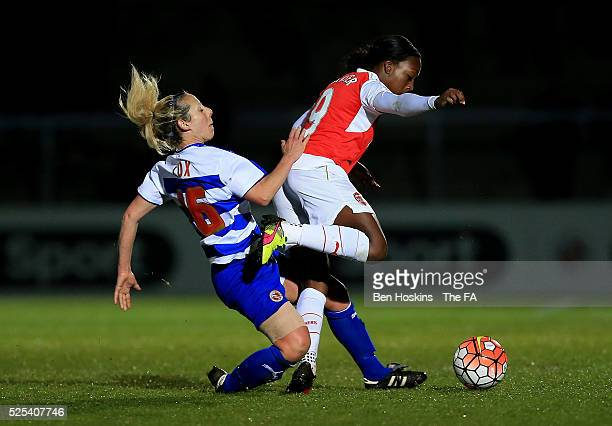 Danielle Carter of Arsenal is tackled by Shelly Cox of Reading during the WSL 1 match between Reading FC Women and Arsenal Ladies FC on April 27 2016...